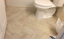 Hall Bath porcelain plank floor herringbone design